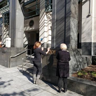 Nancy and Karen Praying at the NEA Office in Washington, DC
